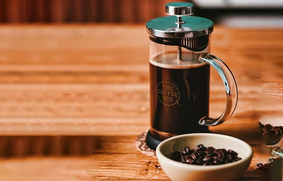 French press coffee brewing-